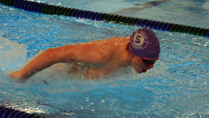 by: TIMES PHOTO: MATT SINGLEDECKER - Sunset boys swimmer Tristan Furnary won two events for the Apollos and was part of two relay squads.