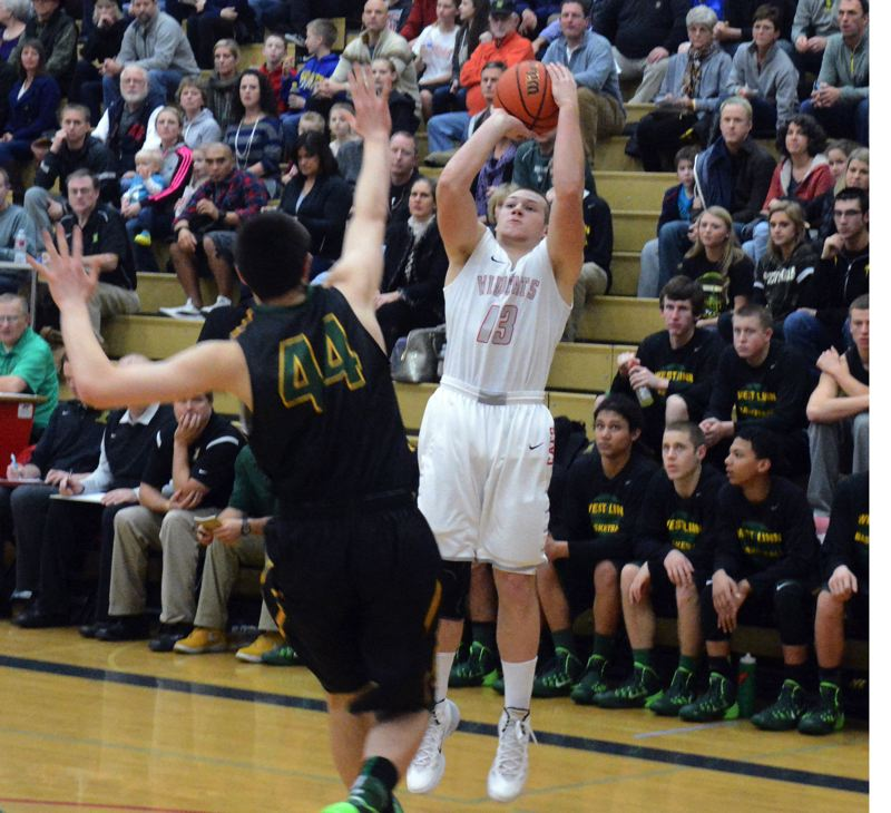 by: TIMES PHOTO: MATT SINGLEDECKER - Westview senior wing Mitch Kekel puts up a perimeter jumper in the second quarter against West Linn.