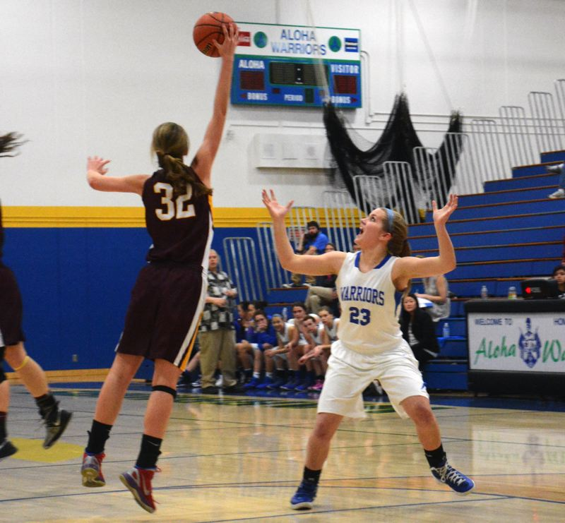 by: TIMES PHOTO: MATT SINGLEDECKER - Aloha senior forward Makenzie Johnsen watches an Eagle steals a loose ball in the first quarter of the Warriors loss to The Dalles on Tuesday.
