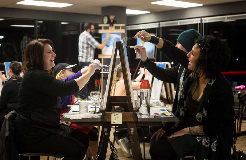 by: TIMES PHOTO: JONATHAN HOUSE - Michelle Birbank, left, and Jill Gorretta laugh as they enjoy a painting class at Vine Gogh Artist Bars new studio in Tigard.