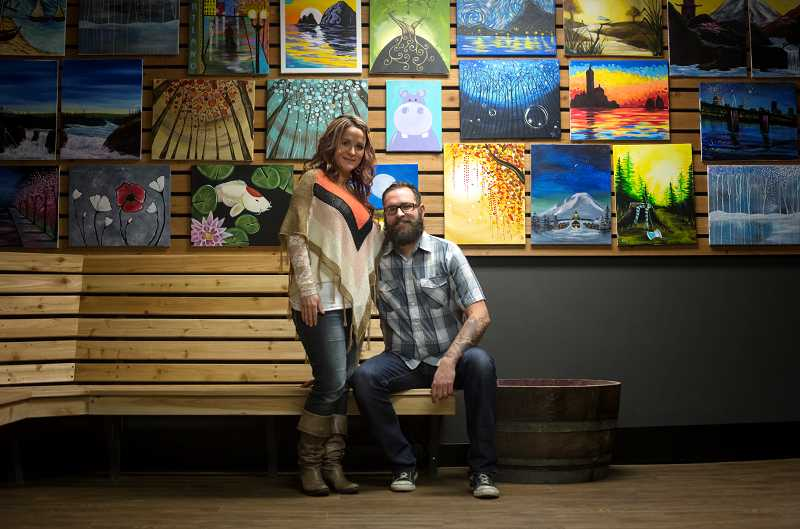 by: TIMES PHOTO: JONATHAN HOUSE - Vine Gogh Artist Bar owner Jenny Schildan and her husband Paul both teach classes at their painting studio.