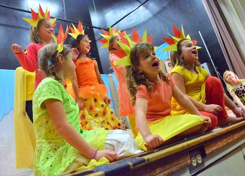 by: REVIEW PHOTOS: VERN UYETAKE - Brightening up the stage with Hope Grows were Lake Grove Elementary School student sun splashes, from left, back row: Sasha Clopton, Sofie Howard and Parker Von Allmen; and front row: McKenzie Helle, Jordan Devlin and Natalie Hills.