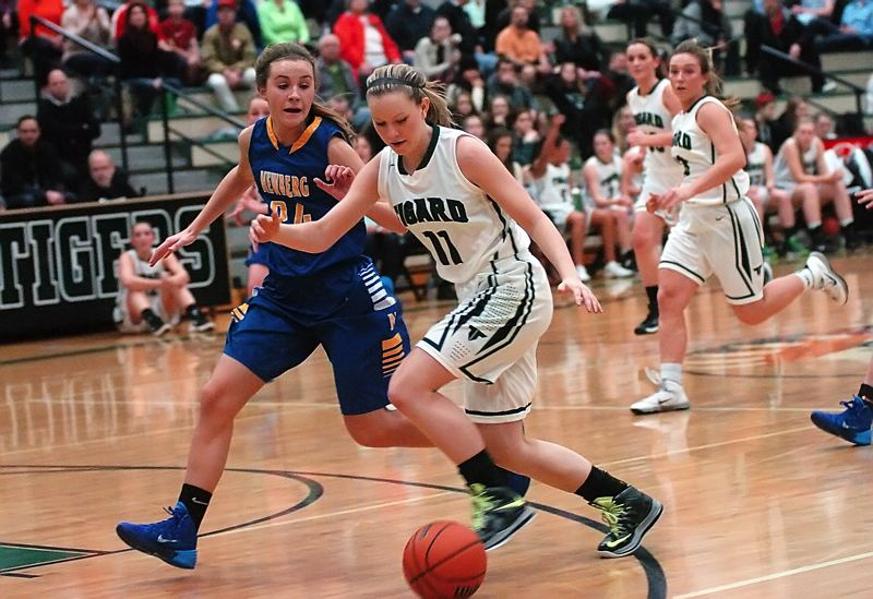 by: DAN BROOD - ON THE DRIVE -- Tigard High School senior Hannah Armstead (11) looks to get to the basket against Newberg's Sabrina Salmons in Friday's game. Tigard got a 57-20 victory.
