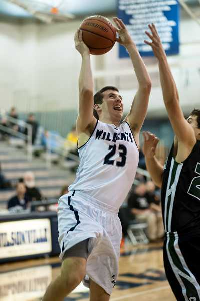 by: GREG ARTMAN - Versatile senior Tyler Martin is a key member of the Wilsonville boys basketball team as its sixth man.