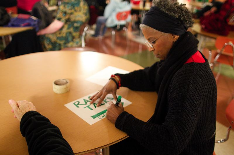 by: TRIBUNE PHOTO: JAIME VALDEZ - Donna Maxey draws a sign for her next event. Race Talks is held every second Tuesday at the Kennedy School; Race Talks 2 is held every first Tuesday at Jefferson.
