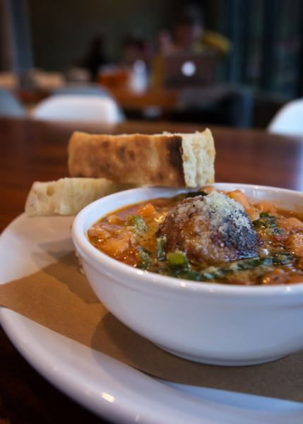 by: TRIBUNE PHOTO: JONATHAN HOUSE - The Italian wedding soup - similar to minestrone - includes a big meatball and a side of pizza bianca at Roman Candle Baking Co. on Southeast Division Street. Stumptown founder Duane Sorenson opened the eatery on busy Division.