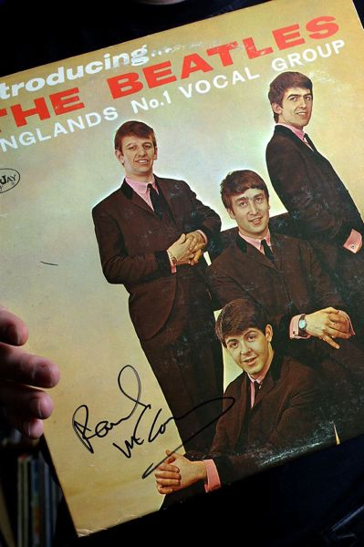 by: TRIBUNE FILE PHOTO: JIM CLARK - Music Millennium hosts a big Beatles event on Jan. 21, when the groups U.S. albums will be released on CD. One of Music Millennium owner Terry Curriers prized possesions is rare version of a Beatles album signed by Paul McCartney.