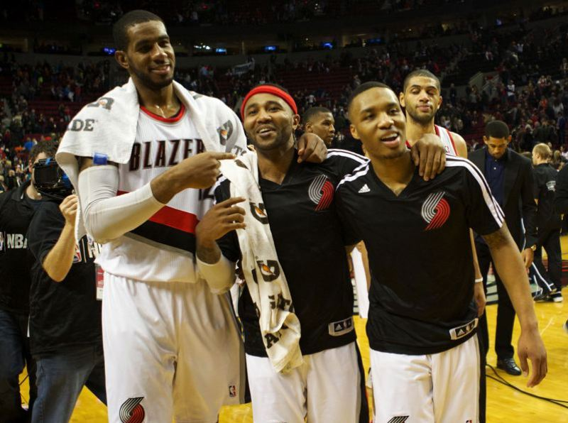 (From left) Trail Blazers LaMarcus Aldridge, Mo Williams and Damian Lillard walk off the court after defeating the Cleveland Cavaliers 108-96 Wednesday night at Moda Center.