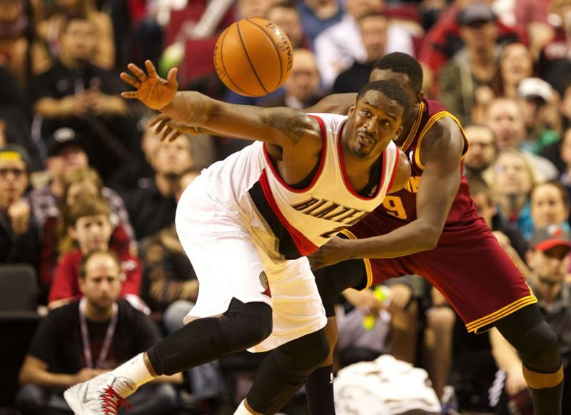 Blazers guard Wesley Matthews strips the ball from Cleveland forward Luol Deng.