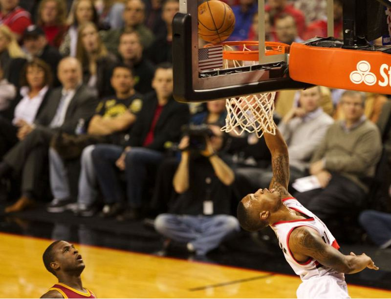 Damian Lillard connects on a reverse layup against Cleveland guard Dion Waiters.
