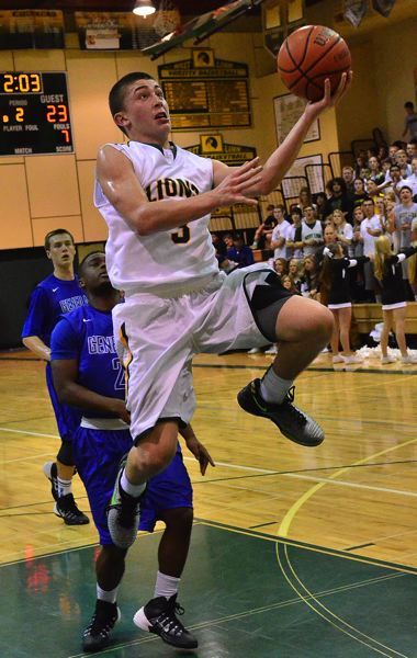 by: VERN UYETAKE - Payton Pritchard elevates for a layup during Tuesday's victory over Grant. Pritchard has scored 57 points combined in the Lions' last two games.