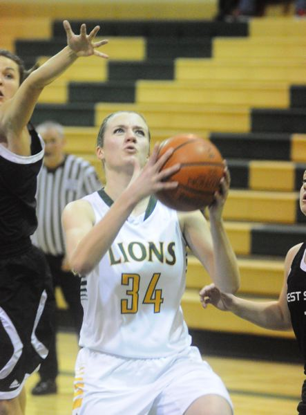by: MATTHEW SHERMAN - West Linn's Genna Hughes dodges West Salem defenders en route to the basket in last week's victory over the Titans.