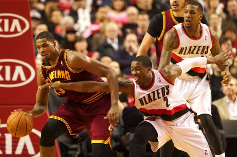 by: TRIBUNE PHOTO: JAIME VALDEZ - Trail Blazers guard Wesley Matthews reaches for the ball against Cleveland Cavaliers guard Dion Waiters during Wednesday night's Portland victory at Moda Center.