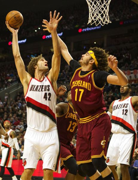by: TRIBUNE PHOTO: JAIME VALDEZ - Blazers center Robin Lopez shoots over Cleveland Cavaliers center Anderson Varejao.