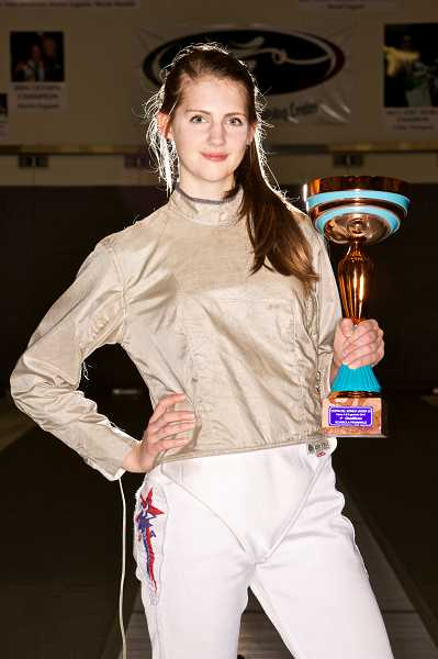 by: TIMES PHOTO: JAIME VALDEZ - Raleigh Hills resident Sage Palmedo poses with the World Cup shes accumulated in her still-blossoming fencing career.