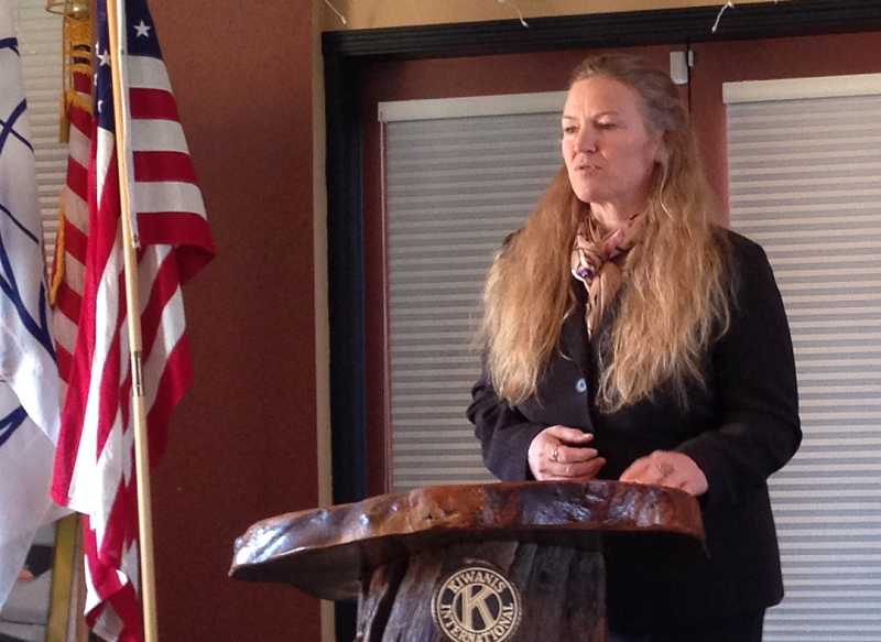 by: CONTRIBUTED PHOTO - Darcy Bedortha, who is helping spearhead the Heart of Oregon effort in Prineville, speaks at a Prineville Kiwanis meeting.