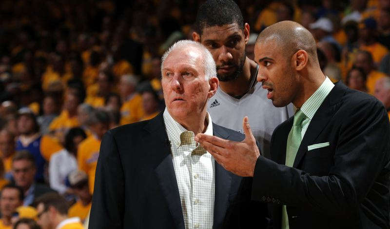 by: COURTESY OF SAN ANTONIO SPURS - Ime Udoka (right) is one of the top assistants to San Antonio coach Gregg Popovich (left), who welcomes Udoka's opinions on how to use All-Star Tim Duncan and others on the team.