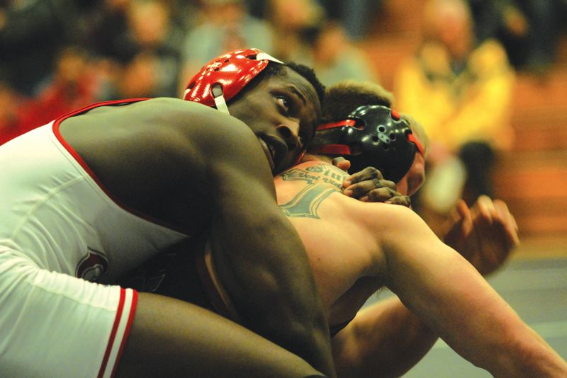 by: PAMPLIN MEDIA GROUP: DAVID BALL - David Douglas graduate Ihog Odighizuwa keeps North Idahos V.J. Giulio on the mat in the closing seconds of his 7-4 win at 197 pounds on Saturday.