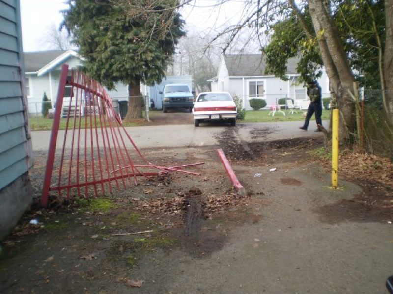 by: CLACKAMAS COUNTY SHERIFF'S OFFICE - Phillip Lamar Higginbotham drive his car through this fence trying to escape police on Saturday.