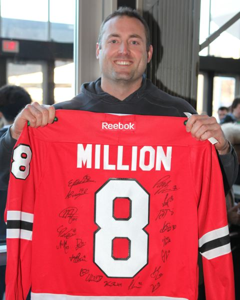 by: COURTESY OF BRYAN HEIM/WINTERHAWKS - Rian Maciog became the Winterhawks' eight-millionth fan at Sunday's game against Spokane at Memorial Coliseum. He won tickets the 2104 playoffs, season tickets for the 2014-15 season and a spot in Friday's Dash For Cash.
