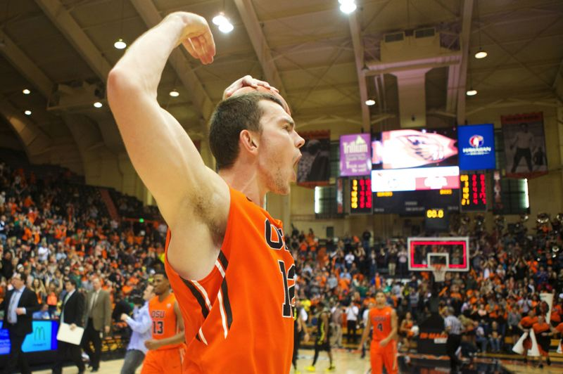 Oregon State's Angus Brandt raises his arms in front of a group of Beavers fans after OSU beat the Oregon Ducks 80-72 Sunday night at Gill Coliseum.