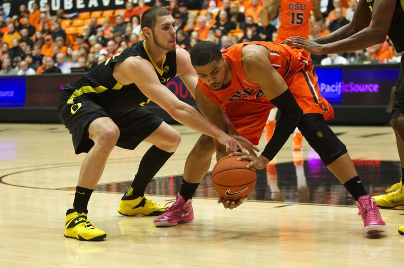 Oregon's Ben Carter (left) ties up Oregon State's Daniel Gomis.
