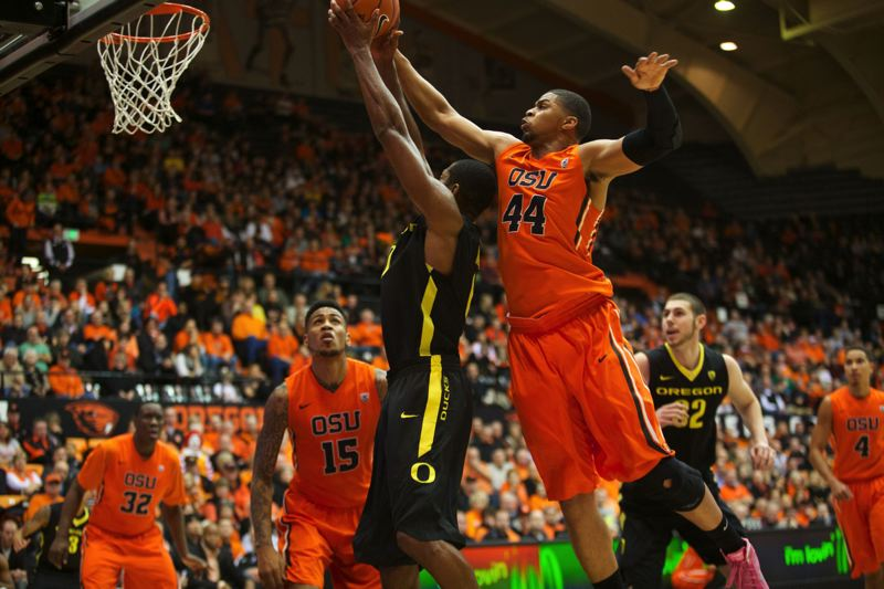 Devon Collier of Oregon State comes in to block a first-half shot by Oregon's Mike Moser.