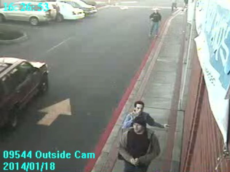 by: MILWAUKIE POLICE DEPARTMENT - A still from surveillance footage of the two suspects who robbed an AT&T store.