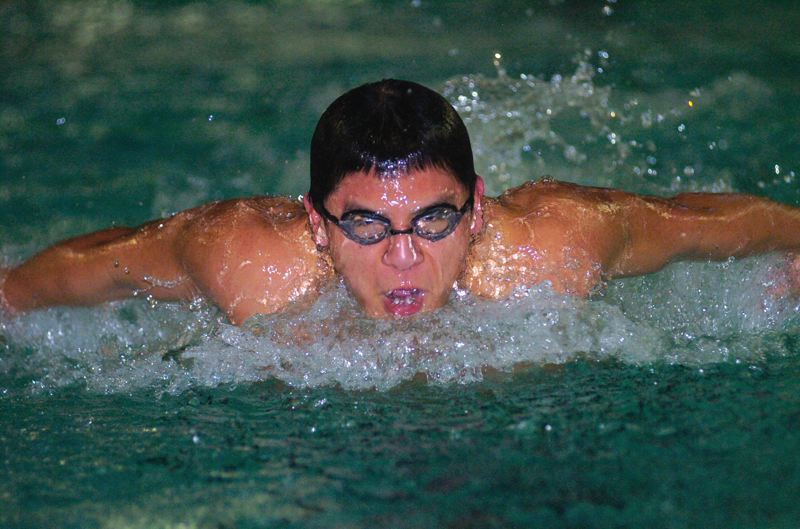 by: SANDY POST: PARKER LEE - Sandys Hipolito Hernandez breaks through the water during the butterfly race in last weeks dual win over Rex Putnam.
