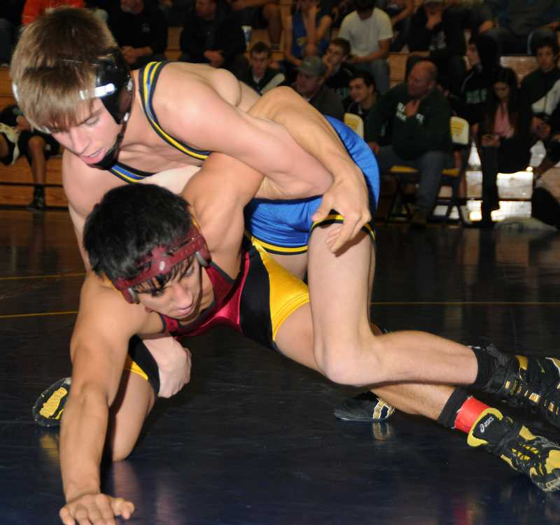 by: LON AUSTIN/CENTRAL OREGONIAN - Trayton Libolt defeats Francisco Barrerra of Ontario during Thursday night's Crook County Duals. The Cowboys went on to win the dual 79-0 and also defeated Thurston 62-12 on the night.