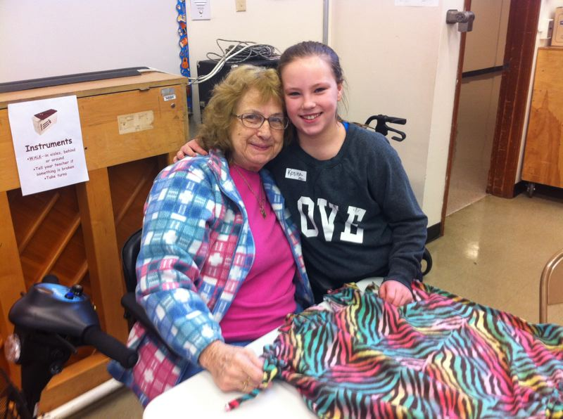 by: PHOTO BY SHER JOHNSON - Gilman Park Assisted Living resident Lela Miller teams up with lunch buddy Korrina, a fifth grader at Gaffney Lane Elementary School, to make cozy cat blankets for felines living in the Cat Adoption Team Shelter in Sherwood.