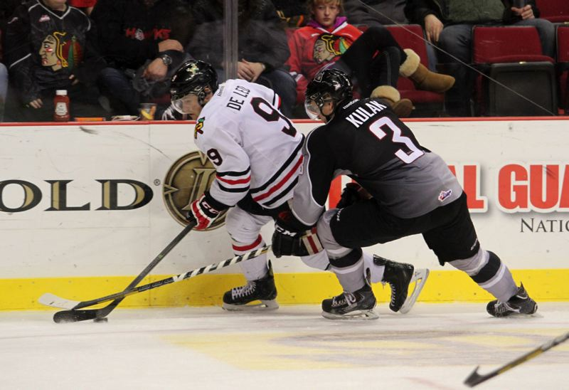 Hawks forward Chase De Leo looks to find room to pass.