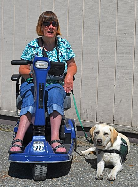 by: CONTRIBUTED PHOTO: SUMMIT ASSISTANCE DOGS - Diana and Hyak, therapy dog and new companion.