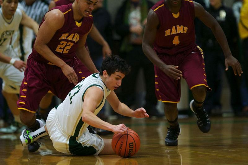by: TRIBUNE PHOTO: JAIME VALDEZ - Jesuit Crusaders guard Jack Bell dives for a loose ball against Central Catholic, as Rams players Cameron Scarlett (left) and LaMar Winston move in during the first half Friday at Jesuit. The Crusaders won 40-35, and beat Lincoln 48-44 last week as well.
