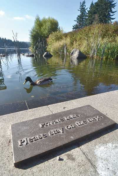 by: REVIEW FILE PHOTO - This sign, posted by the city, discourages the public from trying to enter Lakewood Bay, part of Oswego Lake, at lower Millennium Plaza Park.