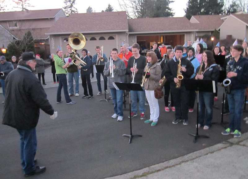 by: TIMES PHOTO: BARBARA SHERMAN - About half of the Tigard High School marching band, led by director Jim Irving (left), showed up at the home of World War II veteran Marion Hill in Summerfield on Saturday to help him celebrate his 94th birthday by playing some songs in his honor.