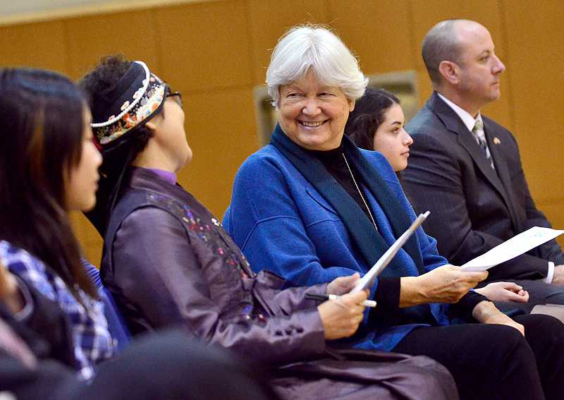 by: TIDINGS PHOTO: VERN UYETAKE - West Linn-Wilsonville Deputy Superintendent Jane Stickney, right, shares a laugh with visiting Korean Principal Wi-ja Ryu at a ceremony welcoming the Korean students Jan. 13.