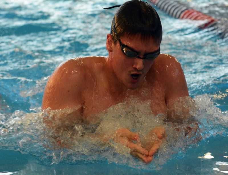 by: TIMES PHOTO: MATT SINGLEDECKER - Beaverton boys swimmer Cortlandt Nelsen won the 200 individual medley against Lincoln on Thursday.