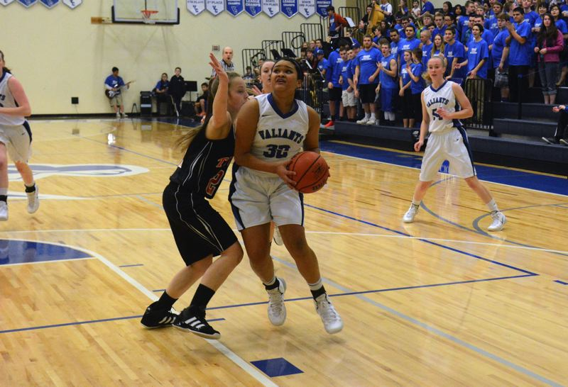by: TIMES PHOTO: MATT SINGLEDECKER - Valley Catholic wing Kaylynn Bush drives to the hoop for a basket against Clatskanie.