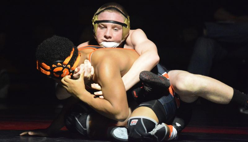 by: TIMES PHOTO: MATT SINGLEDECKER - Southridge 145-pound wrestler Nicholas Piwonka pinned Beavertons Joseph Epsero in the second round in the Skyhawks win over the Beavers on Thursday.