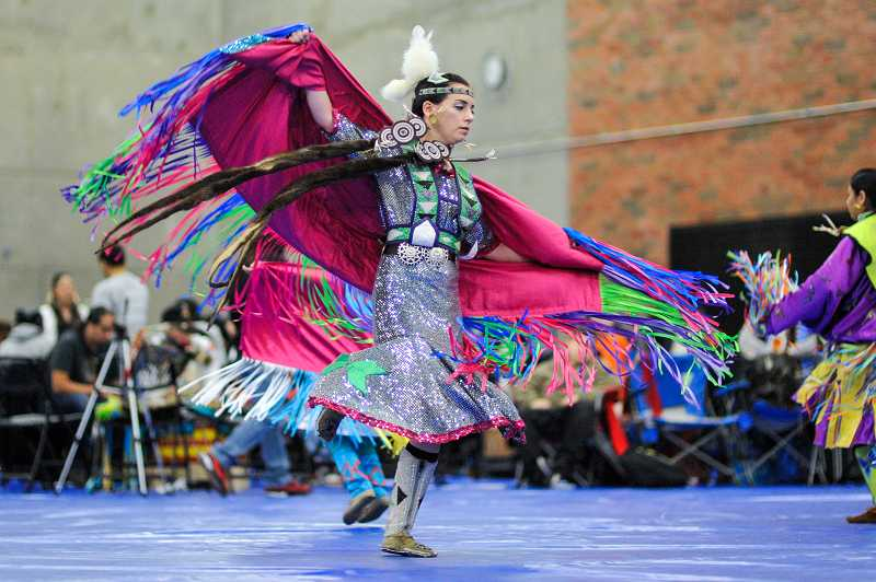 by: TIMES PHOTO: JOHN LARIVIERE - Sydney Moore, a Nez Perce Native American, participates in a girls dance during Saturday's Winter Powwow.