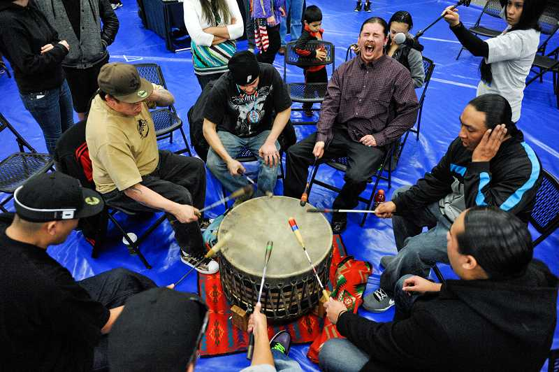 by: TIMES PHOTO: JOHN LARIVIERE - Members of Wy'East drum group perform during the grand entry of dancers.