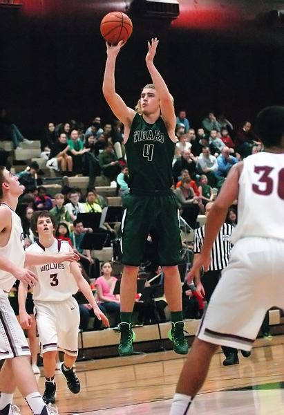 by: DAN BROOD - JUMPER -- Tigard senior Jett Even goes up for a jump shot in Friday's contest.