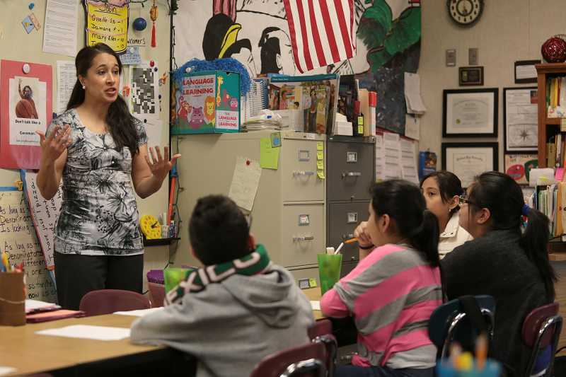 by: TIMES PHOTO: JONATHAN HOUSE - Deer Creek Elementary School teacher Maria Copelan talks works with her 5th grade English Language Learners class. Copelan likes to use science as a means to help her students understand proper English usage.