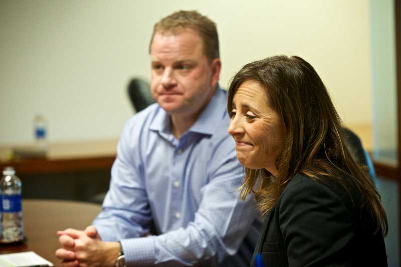by: TIMES PHOTO: JAIME VALDEZ - Mike Maxwell, vice president and general manager of the Pacific Northwest market, and Erika Markel, listen as students at Beverly Cleary School discuss their documentary, A Message to Congress, that theyre working on for a school project. The documentary addresses the dangers of texting while driving.