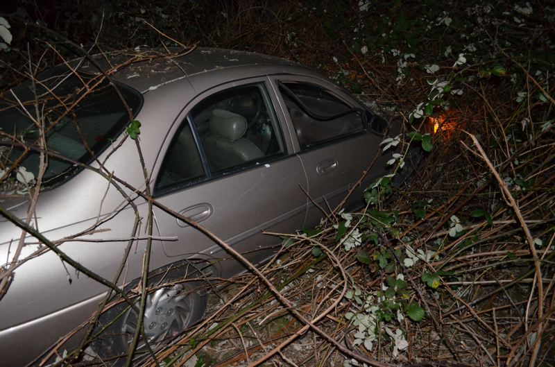 by: CLACKAMAS COUNTY SHERIFF'S OFFICE - Michael Newell's vehicle after he crashed it near the intersection of Mabel and Merganser roads in Gladstone.