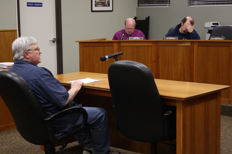 by: SPOTLIGHT PHOTO: ROBIN JOHNSON - Joe Lewis, member of the Scappoose School District Board of Directors, requested the city of Scappoose not rezone the district's property from commercial to public lands as it could potentially decrease the land's property value.