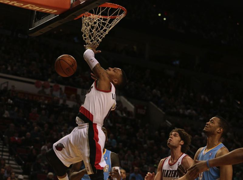 Damian Lillard finishes with a slam.