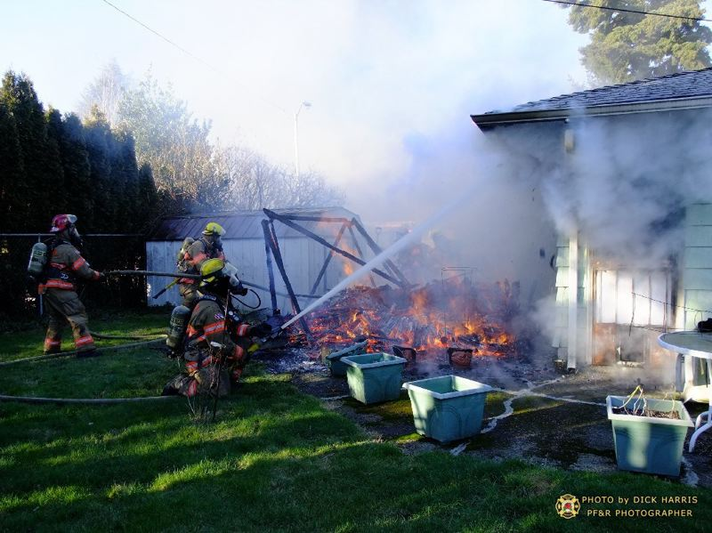 by: PORTLAND FIRE & RESCUE/DICK HARRIS - Acetylene gas tanks were in a garage that caught fire on Jan. 24.