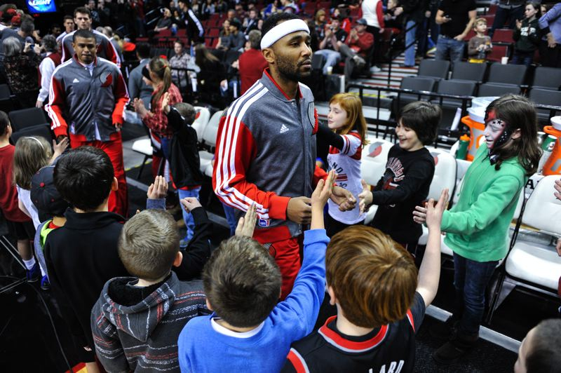 Young fans greet Mo Williams and other Blazers before Saturday's game against Minnesota.
